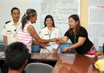 Mayor Eva turns-over Financial Assistance to Typhoon Egay Victims